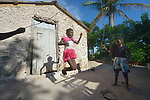 Seven-year old Iznaida Dalmas jumps rope in front of her family's new home in Picmy, a village on the Haitian island of La Gonave where Service Chr&eacute;tien d&rsquo;Ha&iuml;ti is working with survivors of Hurricane Matthew, which struck the region in 2016. Holding one end of the rope is her sister Erm Jouna. <br /> <br /> SCH, a member of the ACT Alliance, is helping families like this one repair or rebuild their homes on the island.