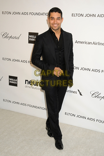 Wilmer Valderrama.21st Annual Elton John Academy Awards Viewing Party held at West Hollywood Park, West Hollywood, California, USA..February 24th, 2013.oscars full length black shirt suit   .CAP/ADM/BP.©Byron Purvis/AdMedia/Capital Pictures.