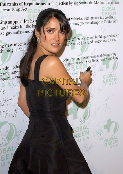 "SALMA HAYEK.attends Global Green USA's ""Rock the Earth"" Party held at The Day After Club in Hollywood, California, USA, February 24th 2005.half length black dress writing on wall .Ref: DVS.www.capitalpictures.com.sales@capitalpictures.com.©Debbie VanStory/Capital Pictures"