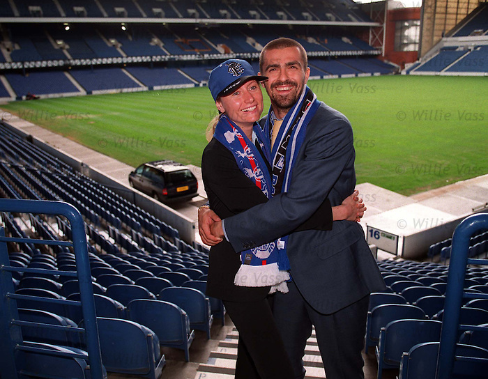 Sergio Porrini signs for Rangers and brings his wife Barbara along fr a tour of the stadium