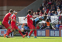 Mathieu Baudry of Leyton Orient appears to make last contact before the ball passes Goalkeeper Matt Ingram of Wycombe Wanderers to give Wycombe a 1-0 lead during the Sky Bet League 2 match between Leyton Orient and Wycombe Wanderers at the Matchroom Stadium, London, England on 19 September 2015. Photo by Andy Rowland.