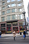 Women cross the street in front of the Reliance Building, a Chicago landmark, at 32 N. State St. in Chicago, Illinois on March 23, 2009.