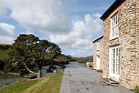 A slate terrace which runs around the outside of the house has a spectacular view over the estuary
