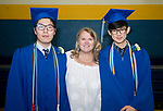 WINSTED, CT-062317JS06-Kelly Gilbert, the school nurse at the Gilbert School, poses with the two international students, Ao Sun, left, and Shibo Jai, right, that she has housed for two, and three years, prior to graduation ceremonies Friday at the Gilbert School in Winsted. <br /> Jim Shannon Republican-American