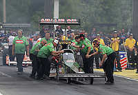 May 10, 2013; Commerce, GA, USA: NHRA crew members for top fuel dragster driver Terry McMillen during qualifying for the Southern Nationals at Atlanta Dragway. Mandatory Credit: Mark J. Rebilas-