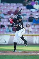 Salem-Keizer Volcanoes left fielder Diego Rincones (19) at bat during a Northwest League game against the Eugene Emeralds at Volcanoes Stadium on August 31, 2018 in Keizer, Oregon. The Eugene Emeralds defeated the Salem-Keizer Volcanoes by a score of 7-3. (Zachary Lucy/Four Seam Images)