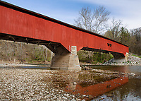 Sugar Creek flows westward under Deers Mill Covered Bridge in spring in Turkey Run State Park, Parke County, Indiana