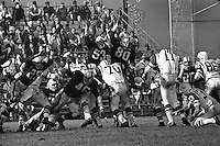 Oakland Raiders playing at Frank Youell field in downtown Oakland.<br /> try to block field goal. (1964 photo..by Ron Riesterer)