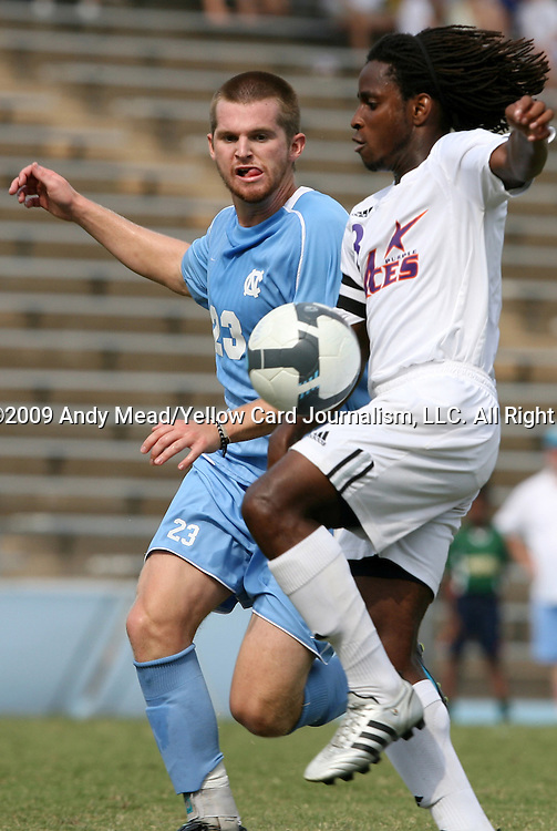 06 September 2009: UNC's Drew McKinney (23) and Evansville's Reggie Edu (8). The University of North Carolina Tar Heels defeated the Evansville University Purple Aces 4-0 at Fetzer Field in Chapel Hill, North Carolina in an NCAA Division I Men's college soccer game.