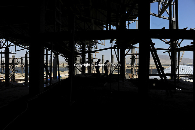 Workers are seen on site in what will become one of several restaurants at the Khazar Islands project near Sahil, Azerbaijan on July 18, 2012.  The brainchild of Ibrahim Ibrahimov, an Azerbaijani oligarch and billionaire, the artificial Khazar Islands project just southwest of the Azerbaijani capital Baku is being built at a projected cost of $100 billion with an anticipated 800,000 housing units.