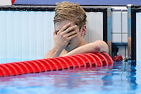 PICTURE BY ALEX BROADWAY /SWPIX.COM - 2012 London Paralympic Games - Day Three - Swimming - Aquatic Centre, Olympic Park, London, England - 01/09/12 - James Hollis of Great Britain reacts after the Men's 100m Butterfly S10 Heats.