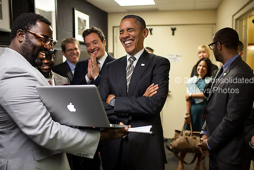 "United States President Barack Obama and Jimmy Fallon are briefed on the ""Slow Jam the News"" segment backstage before taping Late Night with Jimmy Fallon at the University of North Carolina Memorial Hall in Chapel Hill, North Carolina, April 24, 2012..Mandatory Credit: Pete Souza - White House via CNP"
