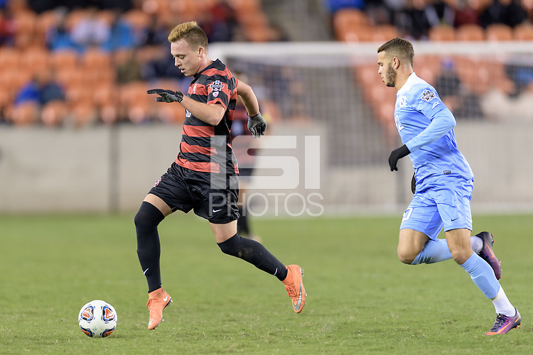 Houston, TX - Friday December 9, 2016: Corey Baird (10) of the Stanford Cardinal races for the North Carolina Tar Heels goal at the NCAA Men's Soccer Semifinals at BBVA Compass Stadium in Houston Texas.