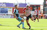 David Noble of Exeter City gets away from Luke O'Nien of Wycombe Wanderers during the Sky Bet League 2 match between Exeter City and Wycombe Wanderers at St James' Park, Exeter, England on 26 September 2015. Photo by Pinnacle Photo Agency.