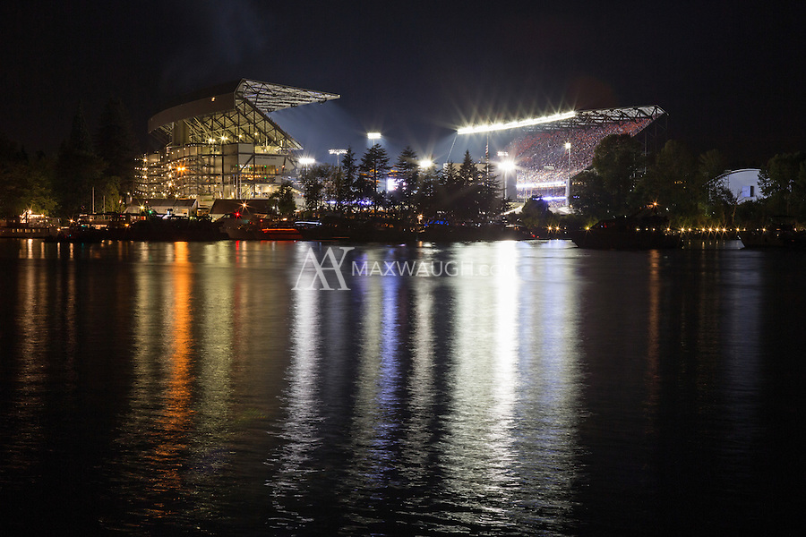 """This photo was taken on Opening Night at the new Husky Stadium, during the game against the Boise State Broncos on August 31, 2013.<br /> <br /> This image is available as a Limited Edition metallic print measuring 30"""" x 20"""" (select the metallic print from the price options when you add to cart).  You may also purchase smaller lustre prints or license it for commercial use.<br /> <br /> *If you are interested in a large limited edition (of 10) aluminum print measuring 36"""" x 24"""", please contact me.<br /> <br /> **No, the watermark will not appear on the final image!"""