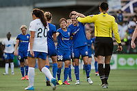 Seattle, Washington - Saturday, July 2nd, 2016: Seattle Reign FC midfielder Keelin Winters (11) celebrates Seattle Reign FC forward Nahomi Kawasumi's (36) second goal during a regular season National Women's Soccer League (NWSL) match between the Seattle Reign FC and the Boston Breakers at Memorial Stadium. Seattle won 2-0.