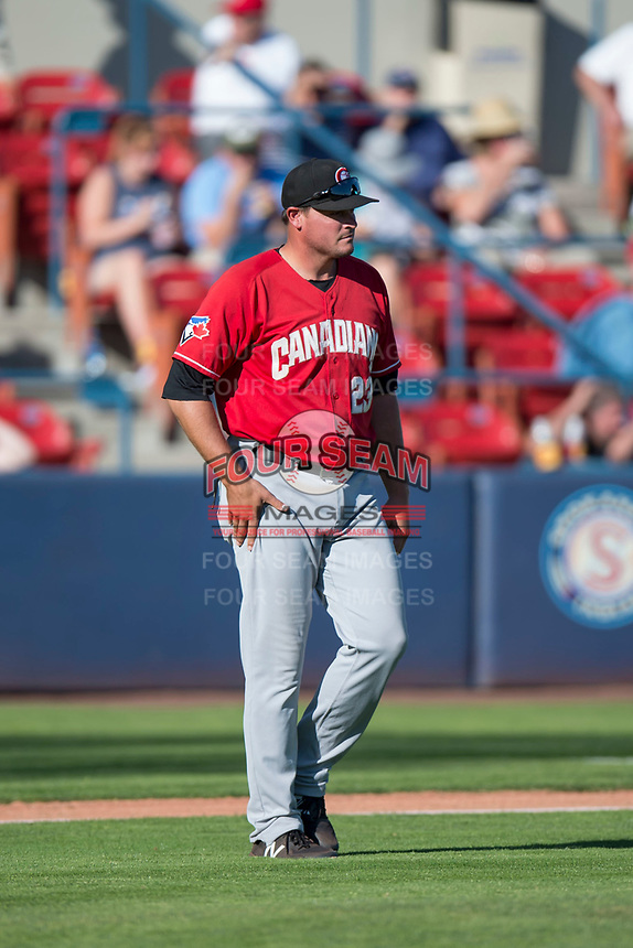 Vancouver Canadians manager Dallas McPherson (23) walks towards field umpire Emma Charlesworth-Seiler (not pictured) during a Northwest League game against the Spokane Indians at Avista Stadium on September 2, 2018 in Spokane, Washington. The Spokane Indians defeated the Vancouver Canadians by a score of 3-1. (Zachary Lucy/Four Seam Images)