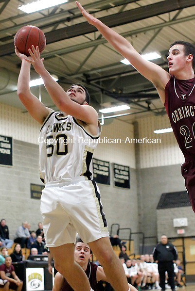 Beacon Falls, CT-10 January 2012-011012CM10-  Woodland's Dave Alves puts up a shot as Torrington's David Canny tries to make the block during their 57-48 win Tuesday night in Beacon Falls.   Christopher Massa Republican-American