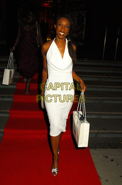 BEVERLEY KNIGHT.The In Style 5th Birthday party at Victoria and Albert Museum, London, UK. .June 19, 2006.Ref: SW.Beverly full length white halterneck dress goody bag.www.capitalpictures.com.sales@capitalpictures.com.©Capital Pictures.