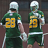 Ethan Larson #29 of Ward Melville, right, and goalie Collin Krieg #28 react as their varsity boys lacrosse team closes in on an 11-7 win over host Chaminade High School in a non-league game on Saturday, April 7, 2018.