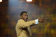 Canton, Ohio - August 1, 2014: Former Defensive End Michael Strahan acknowledges a member of the audience after donning his gold jacket during the Pro Football Hall of Fame's class of 2014 enshrinement dinner in Canton, Ohio  August 1, 2014. Strahan had 22.5 sacks in a single season (2001) and lead the NFL in sacks in 2001 and 2003.  (Photo by Don Baxter/Media Images International)