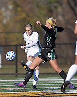 College of St Rose forward Molly Harpster (9) passes the ball as Wilmington University forward Chelsea Grace (8) defends.. In 2012 NCAA Division II Women's Soccer Championship Tournament First Round, College of St Rose (white) defeated Wilmington University (black), 3-0, on Ronald J. Abdow Field at American International College on November 9, 2012.
