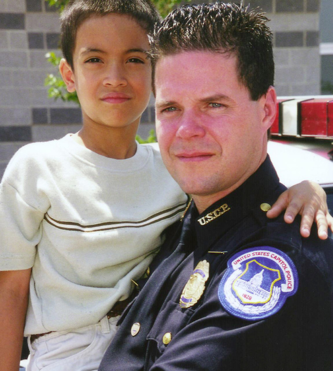 Campbell B. (CB)060900 -- Nick Amigo thanks United States Capitol Police Officer Blain Campbell for reviving him after a near drowning on June 4, 2000, in Bowie, MD...Photo by Chauncey Bowers, PGFD