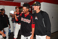Batavia Muckdogs Scott Squier (right) distracts starting pitcher Gabriel Castellanos (center) as Jordan Holloway (left) comes from the hallway to pie Castellanos after Batavia defeated Mahoning Valley 1-0 on June 24, 2015 at Dwyer Stadium in Batavia, New York.  Castellanos, Brett Lilek and Steven Farnworth combined on a perfect game, the first in the teams 76 year history.  (Mike Janes/Four Seam Images)