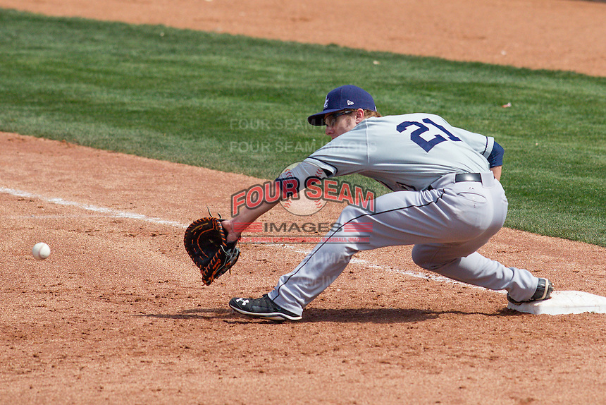 New Orleans Zephyrs First Baseman Mark Canha (21) stretches for a throw from 2nd during the Pacific League game at the Chickasaw Bricktown Ballpark against the Oklahoma City RedHawks on April 13, 2014 in Oklahoma City, Oklahoma.  The RedHawks defeated the Zephyrs 4-3.  (William Purnell/Four Seam Images)