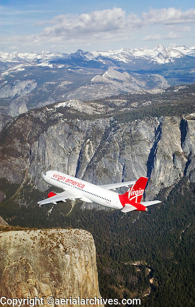 aerial photograph of N628VA, Virgin America Airlines Airbus A320-214, over Yosemite, California, Half Dome with Yosemite Valley in the background