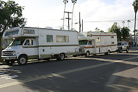A pari of RVs parked on Abbott Street in Ocean Beach, Friday, February 1 2008.  San Diego City Council are studying the cost of a ban on overnight parking of RVs in coastal neighborhoods.
