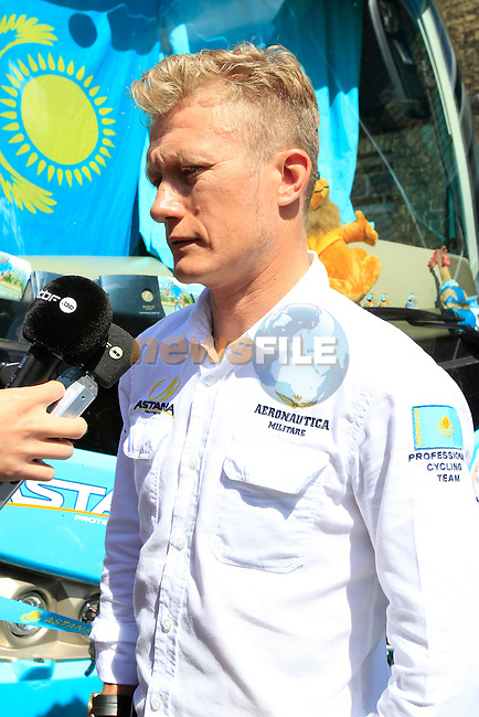 Alexander Vinokourov Astana team at the bus before sign on in Cambridge before the start of Stage 3 of the 2014 Tour de France running 155km from Cambridge to London. 7th July 2014.<br /> Picture: Eoin Clarke www.newsfile.ie