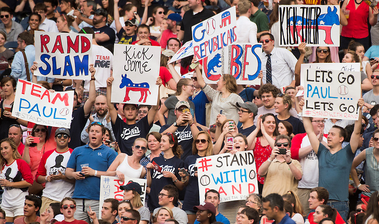 UNITED STATES - JUNE 11: Sen. Rand Paul fans cheer and wave posters in the stands as Sen. Paul bats during the 54th Annual Roll Call Congressional Baseball Game at Nationals Park in Washington on Thursday, June 11, 2015. The Democrats beat the Republicans 5-2. (Photo By Bill Clark/CQ Roll Call)