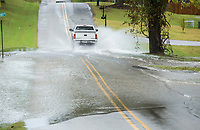 NWA Democrat-Gazette/BEN GOFF @NWABENGOFF<br /> A truck drives through flood water Sunday, Oct. 6, 2019, on South Osage Road in Rogers.
