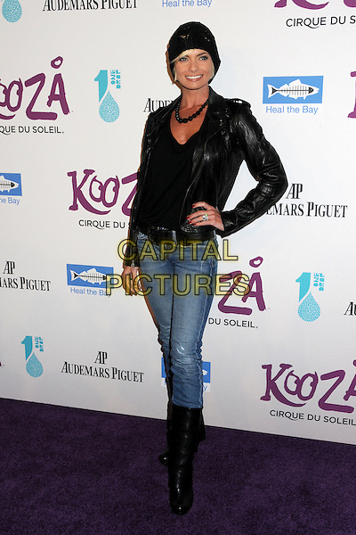 JAIME PRESSLY.Cirque du Soleil's KOOZA Opening Night Gala held at the Santa Monica Pier, Santa Monica, California, USA..October 16th, 2009.full length black jeans denim tucked into boots leather jacket hat jamie hand on hip.CAP/ADM/BP.©Byron Purvis/AdMedia/Capital Pictures.