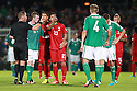 Portugal's Christiano Ronaldo gets a yellow card fromm the Reff after Portugal's  Helder Postiga head butt's Northern Ireland's  McAuley during the first half a World Cup Qualifier in Belfast, Friday September 6th, 2013.  Photo/Paul McErlane