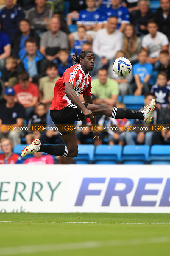 Clayton Donaldson of Brentford - Gillingham vs Brentford - Sky Bet League One Football at Priestfield Stadium, Gillingham, Kent - 17/08/13 - MANDATORY CREDIT: Simon Roe/TGSPHOTO - Self billing applies where appropriate - 0845 094 6026 - contact@tgsphoto.co.uk - NO UNPAID USE