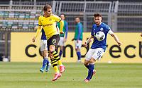 16th May 2020, Signal Iduna Park, Dortmund, Germany; Bundesliga football, Borussia Dortmund versus FC Schalke; S04 Daniel Caligiuri  holds off the challenge from BVB Thorgan Hazard