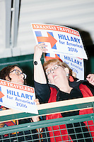 People watch from the balcony as former Secretary of State and Democratic presidential candidate Hillary Rodham Clinton speaks at a rally at Nashua Community College in Nashua, New Hampshire, on Tues. Feb. 2, 2016. Former president Bill Clinton also spoke at the event. The day before, Hillary Clinton won the Iowa caucus by a small margin over Bernie Sanders.