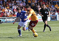 Lewis Kidd pressuring Liam Donnelly closely watched by Referee Don Robertson in the SPFL Betfred League Cup group match between Queen of the South and Motherwell at Palmerston Park, Dumfries on 13.7.19.