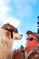 """Dog and doggles, """"Buster"""" and owner Curly, Alaska"""