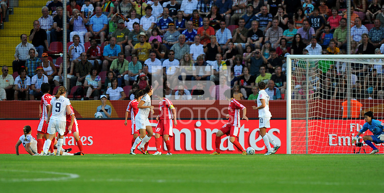 Rachel Buehler (l) of Team USA scores the second goal during the FIFA Women's World Cup at the FIFA Stadium in Dresden, Germany on June 28th, 2011.