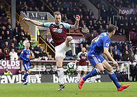 Burnley's Ashley Barnes looks to control under pressure from Leicester City's Jonny Evans<br /> <br /> Photographer Rich Linley/CameraSport<br /> <br /> The Premier League - Burnley v Leicester City - Saturday 16th March 2019 - Turf Moor - Burnley<br /> <br /> World Copyright © 2019 CameraSport. All rights reserved. 43 Linden Ave. Countesthorpe. Leicester. England. LE8 5PG - Tel: +44 (0) 116 277 4147 - admin@camerasport.com - www.camerasport.com