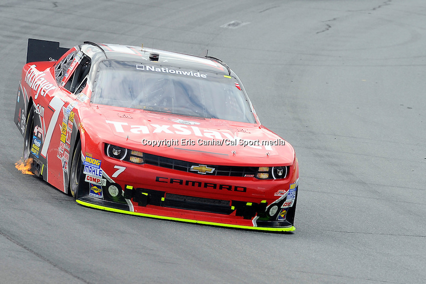 "July 13, 2013 - Loudon, New Hampshire U.S. - Nationwide Series driver Regan Smith's (7) car exhausts flames while racing in the NASCAR Nationwide Series CNBC Prime's ""The Profit"" 200 race being held at the New Hampshire Motor Speedway in Loudon, New Hampshire.   Eric Canha/CSM"