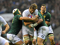Rugby Union. Twickenham, England.Geoff Parling of England tackled during the QBE international match between England and South Africa at Twickenham Stadium on November 24, 2012 in Twickenham, England.