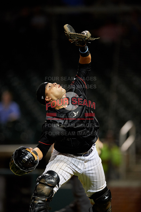 Birmingham Barons catcher Alfredo Gonzalez (1) settles under a pop up during a game against the Tennessee Smokies on August 16, 2018 at Regions FIeld in Birmingham, Alabama.  Tennessee defeated Birmingham 11-1.  (Mike Janes/Four Seam Images)