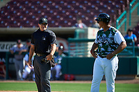 Lake Elsinore Storm manager Tony Tarasco (33) talks to home plate umpire Randy Wilmes during a California League game against the Inland Empire 66ers on April 14, 2019 at The Diamond in Lake Elsinore, California. Lake Elsinore defeated Inland Empire 5-3. (Zachary Lucy/Four Seam Images)