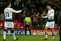 Son Heung-Min and Erik Lamela of Tottenham Hotspur celebrates the victory after Tottenham Hotspur vs Borussia Dortmund, UEFA Champions League Football at Wembley Stadium on 13th February 2019