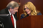 Nevada Assemblyman John Ellison, R-Elko, and Speaker Marilyn Kirkpatrick, D-North Las Vegas, talk on the Assembly floor on the final day of the 77th Legislative session at the Legislative Building in Carson City, Nev., on Monday, June 3, 2013. <br /> Photo by Cathleen Allison