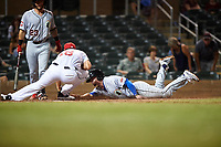 Glendale Desert Dogs Omar Estevez (7) is tagged out by Scottsdale Scorpions relief pitcher Brandon White (18) during an Arizona Fall League game on September 20, 2019 at Salt River Fields at Talking Stick in Scottsdale, Arizona. Scottsdale defeated Glendale 3-2. (Zachary Lucy/Four Seam Images)